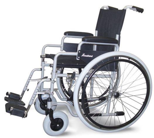"""Carrozzina standard pieghevole ad auto spinta, struttura in lega di metallo (cromo molibdeno acciaio). Ruote posteriori da 24"""", anteriori 200x50 piene soft, tele sedile e schienale ignifughe. Fornita nel colore grigio con le seguenti caratteristiche:  Seduta cm 41-43-46 Bracciolo scrivania (desk) M12 Pedana fissa M20Pedane elevabili (optional) Portata massima kg100"""
